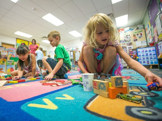 Jillian Christensen, 5, plays with building blocks