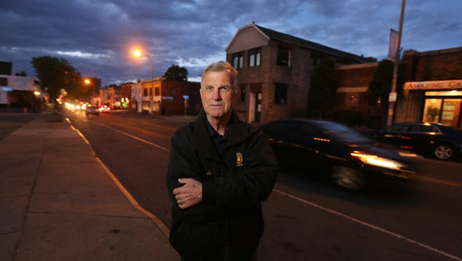 Lynde Johnston retired from the Rochester Police Department after 51 years of service. He is standing along Hudson Avenue near Warsaw Street where officer Daryl Pierson was shot and killed while chasing a suspect.