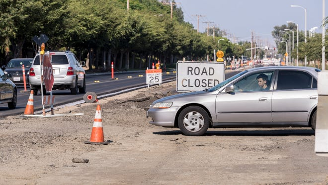 A motorist waits to cross traffic on Houston Avenue between Mooney and Demaree while construction continues on Monday, June 25, 2018. Traffic has been moved to the north side while the south side is repaved.