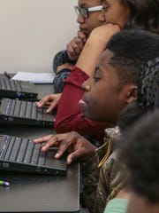 Mikerius Clinkscales, a seventh grade student at Trinity School at Welfare Baptist Church in Belton, works on a laptop in the classroom.