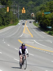 KJ Garner rides her bike from East Nashville to her job at REI in Brentwood. Here she rides down Franklin Road near the Brentwood city limits before crossing the busy intersection of Franklin Road and Old Hickory Boulevard.