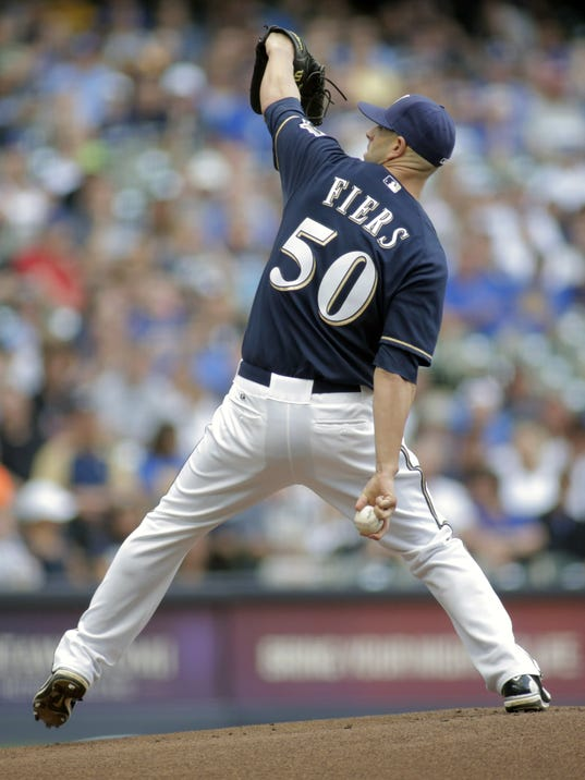 Milwaukee Brewers pitcher Mike Fiers throws to the Los Angeles Dodgers during the first inning of a baseball game Saturday, Aug. 9, 2014, in Milwaukee. (AP Photo/Darren Hauck)