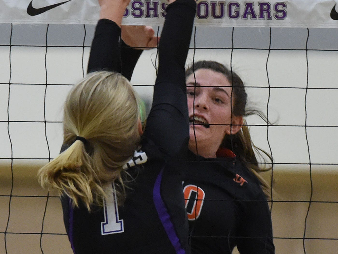 Spanish Springs' Mackenzie O'Connell goes up to block a shot by Douglas' Hailey Hughes in Tuesday's varsity volleyball game at Spanish Springs High School on Sept. 13, 2016.