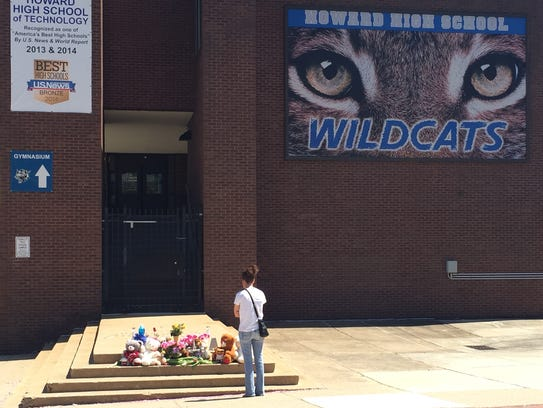 Classmates and community members stopped at the makeshift memorial outside Howard High School of Technology in honor of Amy Joyner-Francis in 2016.