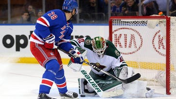 Minnesota Wild goalie Devan Dubnyk (40) makes a save on a short-handed breakaway shot by New York Rangers center Dominic Moore (28) during the second period Thursday at Madison Square Garden in New York.