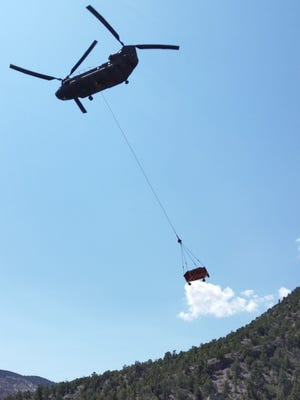 A submitted photo of a helicopter eradicating marijuana plants found on a growing site in Lincoln County.