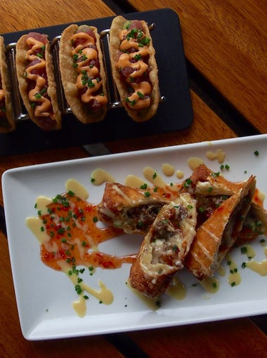 Two of Del Frisco's most popular appetizers: Cheesesteak Eggrolls and Ahi Tacos.