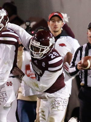 Mississippi State Bulldogs defensive back Kendrick Market (26) celebrates  with defensive back Will Redmond (2) after an interception at Davis Wade Stadium.  The Bulldogs defeat the Razorbacks 17-10. Mandatory Credit: Marvin Gentry-USA TODAY Sports