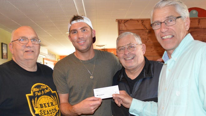 Mike Lautenbach, left, Chase Bjarnarson, Joe Jarosh and Bob Geitner, all Jacksonport Area Business Association officers, pose with a donation for the new sidewalks.