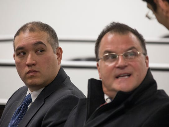 EX-trooper Mark Bessner, left, sits with his attorney Richard Convertino before his arraignment Dec. 21, 2017, in the death of 15-year-old Damon Grimes.