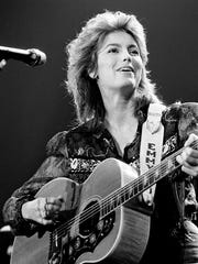 "Emmylou Harris is singing one of her standards for the packed Municipal Auditorium during Volunteer Jam XI Feb. 2, 1985. She performed ""I'm Movin' On"" and ""Last Date."""