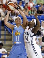 Chicago's Elena Delle Donne is fouled by New York's Sugar Rodgers in the first half of a WNBA preseason game at the Carpenter Center last May.