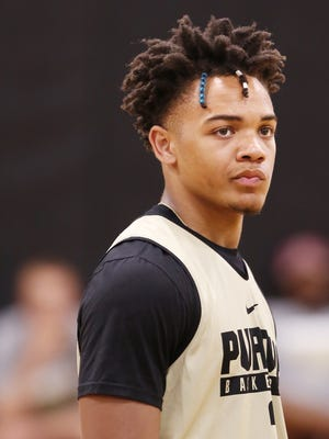 Sophomore guard Carsen Edwards listens as head coach Matt Painter diagrams the defense during Purdue basketball practice Wednesday, June 14, 2017, at Cardinal Court in Mackey Arena.