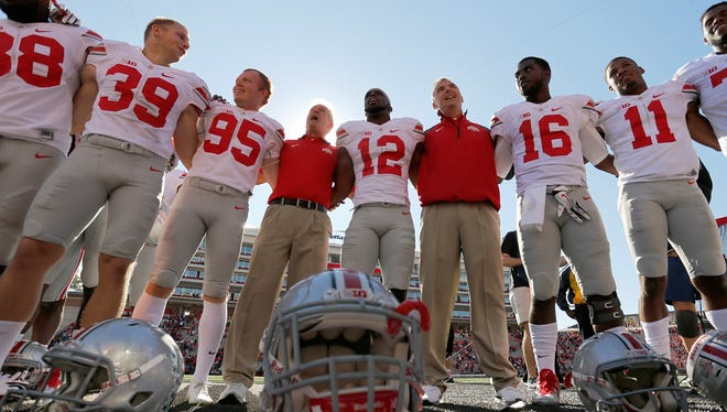Head coach Urban Meyer of the Ohio State Buckeyes sings the school song Carmen Ohio with his team earlier this season.
