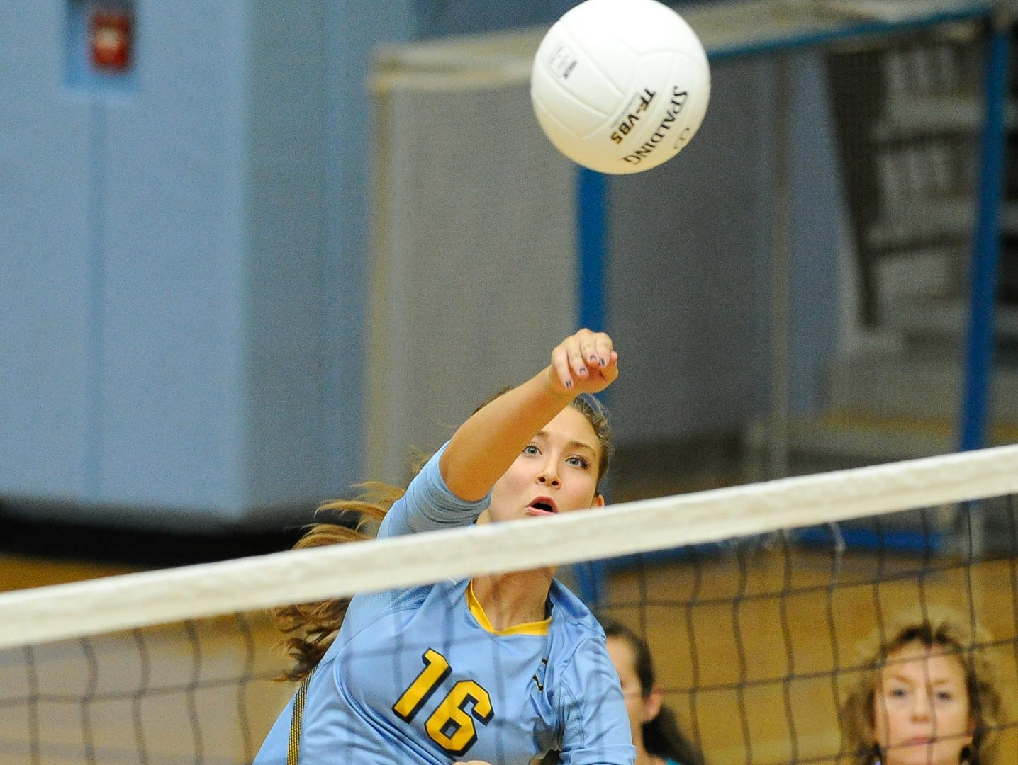 Cape's #16 Isabelle Marsico with a spike in the first game against Conrad Thursday night at Cape Henlopen High School.