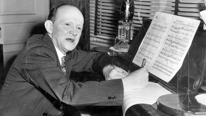 Haven Gillespie, Covington songwriter, works at his piano on one of his new lyrics in 1949.