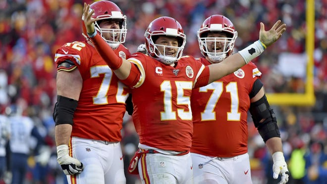 Kansas City's Patrick Mahomes (15) celebrates a touchdown pass with Eric Fisher (72) and Mitchell Schwartz (71) on Sunday against Tennessee. Mahomes threw for three touchdowns and ran for another as the Chiefs won 35-24 to advance to the Super Bowl.