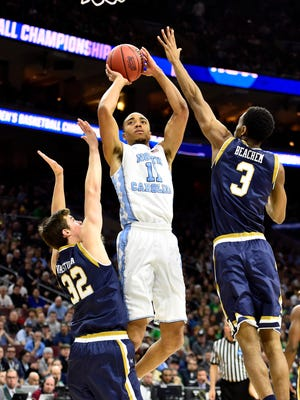 North Carolina Tar Heels forward Brice Johnson (11) shoots against Notre Dame Fighting Irish forward V.J. Beachem (3) and guard Steve Vasturia (32) during the first half in the championship game in the East regional of the NCAA tournament at Wells Fargo Center.