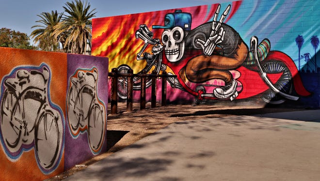 The exterior courtyard of Paz Cantina features bicycle related Chicano murals and art as seen in Phoenix on Feb. 12, 2015.