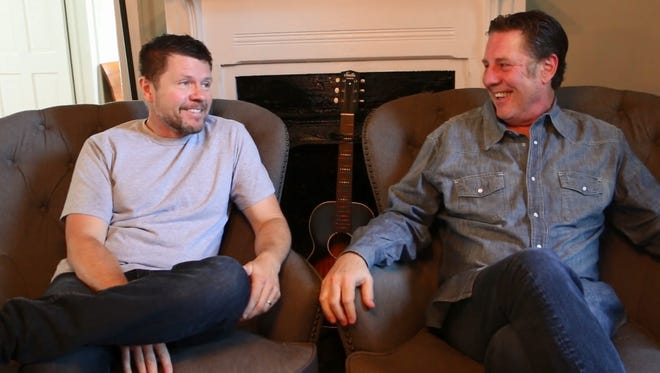 Lee Thomas Miller, left, tells Bart Herbison about writing 'The Perfect Storm'