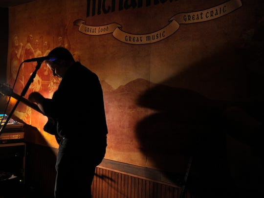 Sean McNamara gets ready to perform with his Irish band at his pub, McNamara's Irish Pub & Restaurant, this month in Donelson. McNamara, 43, opened the pub with his Irish wife, Paula, five years ago after he worked at Mulligan's on Second Avenue.