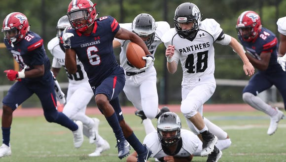 Stepinac's Shawn Harris (6) finds some running room