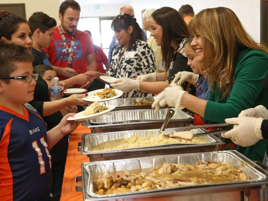 Volunteers serve Thanksgiving meals at the Salvation Army in Cathedral City, November 24, 2016.