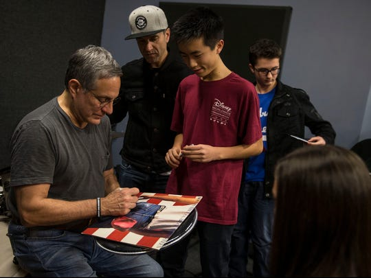 "Robert Lee, 14, of Franklin Township has Bruce Springsteen's ""Born in the U.S.A."" album cover autographed by Max Weinberg."