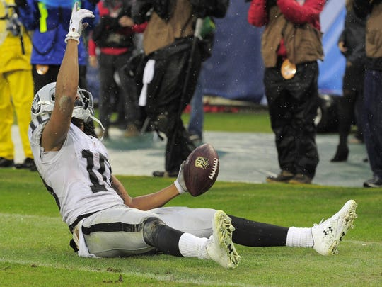 Raiders wide receiver Seth Roberts celebrates after scoring the game winning touchdown during the fourth quarter of a game Nov. 29, 2015, against the Tennessee Titans.