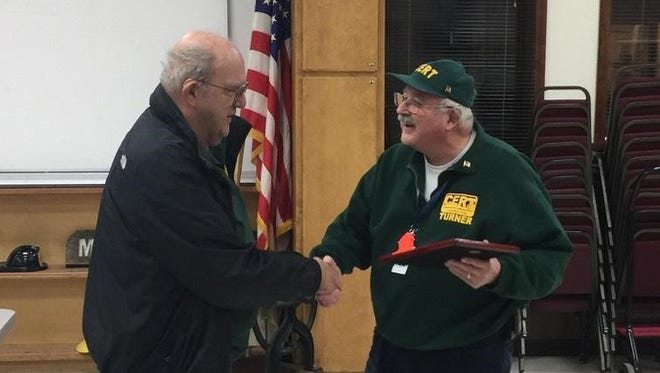 Chuck Roberts, left, presents Turner CERT Volunteer of the Year award to Glenn Pennebaker.