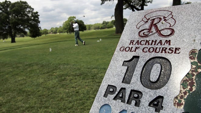 A golfer tees off on the 10th hole at Rackham Golf Course in Huntington Woods.