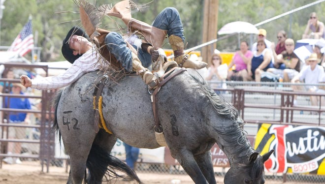 Chauncey Kirby, 23, of Ft. McDowell, Arizona, competes in bareback riding during the 126th annual Payson Rodeo at The Payson Event Center.