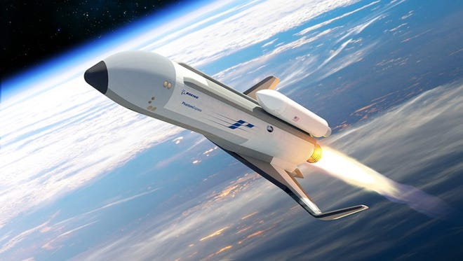 Artist rendering of a launch by Boeing's Phantom Express, which will attempt to demonstrate rapid launch capability under DARPA's Experimental Spaceplane program, or XS-1.