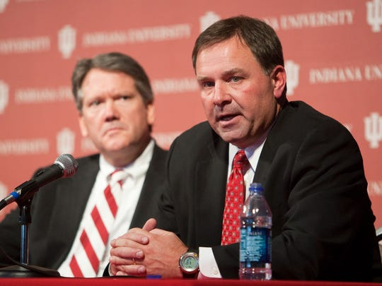 IU AD Fred Glass (left) watches during a question and answer period with Kevin Wilson at WIlson's introductory press conference, Dec. 7, 2010.