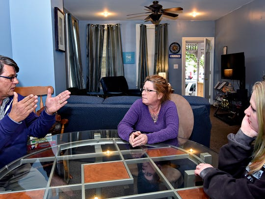Home owner Dave Dunkel, left, talks with residents