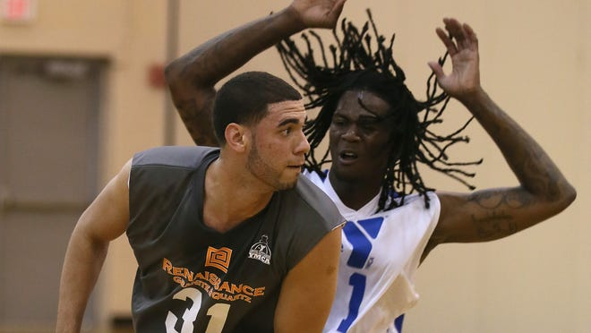 Georges Niang is guarded by Jameel McKay in the Capital City League basketball game last weekend. Niang, Jameel McKay and Dustin Hogue are among the Iowa State men's basketball players showing progress in these relaxed summertime settings.