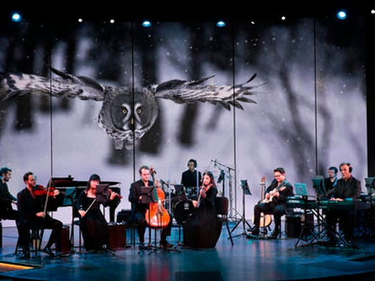 This July 2016 photo provided by Holland America Line shows a live concert aboard the cruise line's Koningsdam ship while footage from BBC Earth of wildlife and wilderness in the polar regions is shown on a screen behind the musicians. Holland America has rolled the partnership with BBC Earth out to all of its ships, with programming that includes games and other activities.