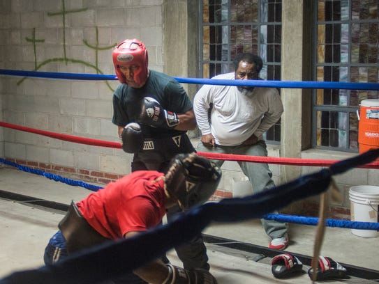 Sarge Ruffin, 60, center, spars with Dentriel Thomas