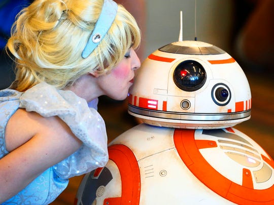 A match made at Disney, Cinderella kisses Star Wars BB-8 droid at Comicon on May 27, 2017 at the Phoenix Convention Center.