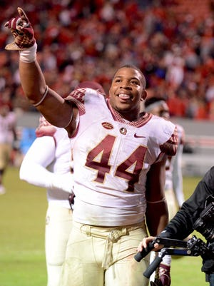 Nov 5, 2016; Raleigh, NC, USA; Florida State Seminoles defensive end DeMarcus Walker (44) gestures to the crowd after a win against the North Carolina State Wolfpack at Carter Finley Stadium. Florida State won 24-20.  Mandatory Credit: Rob Kinnan-USA TODAY Sports