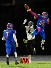 Apollo's Jonh Sithamat leaps to break up a pass to Little Falls receiver Joshua Jennings during the Tuesday, Oct. 24 game at Apollo High School in St. Cloud.
