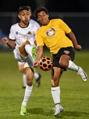 Players battle for control of the ball during a St. Cloud Dynamo FC game against Waconia Thursday, May 17, at Whitney Park in St. Cloud.