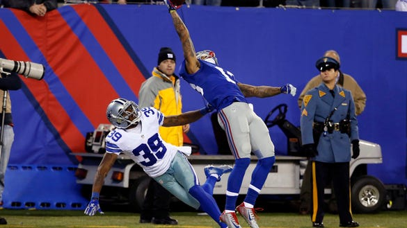 Nov 23, 2014; New York, NY, USA; New York Giants wide receiver Odell Beckham (13) makes a one handed catch for a touchdown in second quarter as he is defended by Dallas Cowboys cornerback Brandon Carr (39) at Metlife Stadium. Mandatory Credit: William Perlman/NJ Advance Media for NJ.com via USA TODAY Sports ORG XMIT: USATSI-180360 ORIG FILE ID: 20141123_pjc_so3_292.JPG