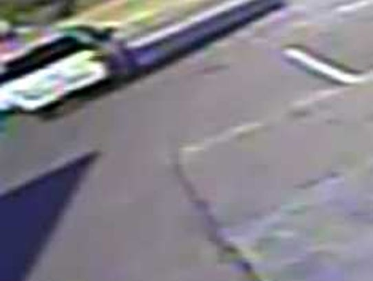 A security camera image shows an SUV that struck and
