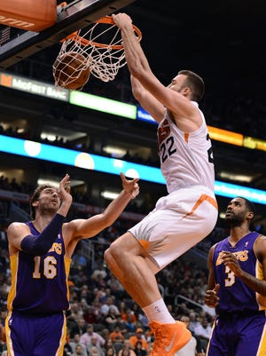 Miles Plumlee dunks home two of his 17 points.
