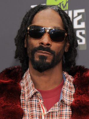 Snoop Dogg arrives at the MTV Movie Awards on April 14, 2013.