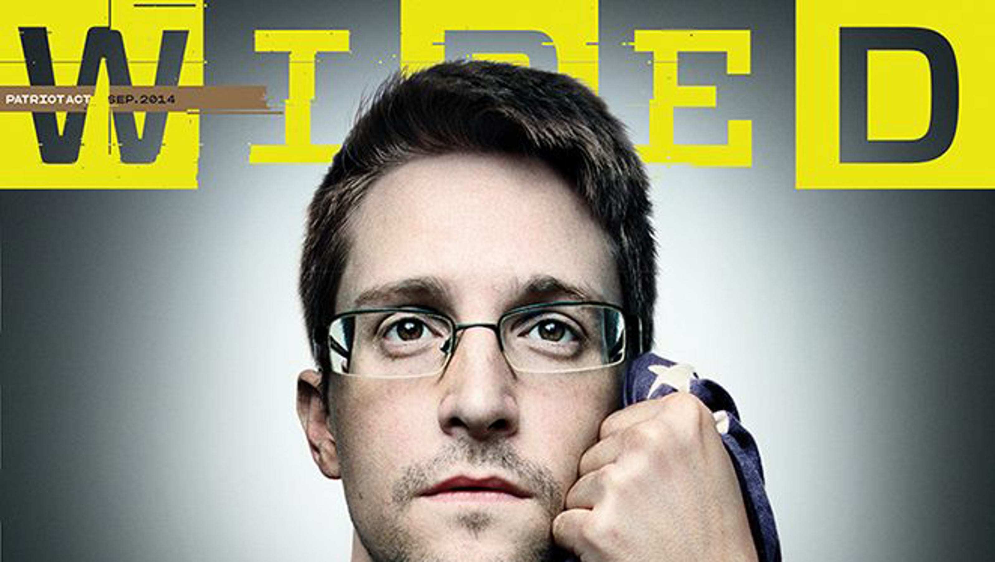 Embracing flag, Snowden says he hopes to return to U.S.