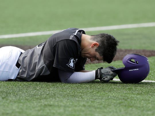 Tennessee Tech's Brennon Kaleiwahea lies on the field after he grounded into the final out in the ninth inning Monday.