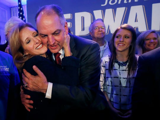Louisiana Gov.-elect John Bel Edwards hugs his wife Donna Edwards as he arrives to greet supporters at his election night watch party in New Orleans, Saturday, Nov. 21, 2015. At right is his daughter Sarah Ellen Edwards. Edwards won the runoff election for Louisiana governor Saturday, defeating the once-heavy favorite, Republican David Vitter, and handing the Democrats their first statewide victory since 2008.