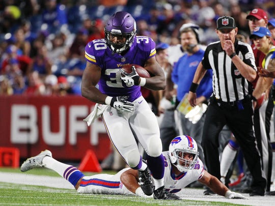 Minnesota Vikings running back C.J. Ham (30) runs away from Buffalo Bills' Matt Milano (58) during the second half of a preseason NFL football game Thursday, Aug. 10, 2017, in Orchard Park, N.Y.